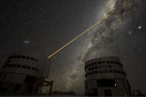 This photograph was produced by European Southern Observatory, by Yuri Beletsky and licensed under the Creative COmmons Attribution 3.0.  http://en.wikipedia.org/wiki/File:A_Laser_Strike_at_the_Galactic_Center.jpg